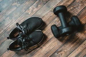Black running shoes and dumbbells