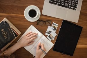 Woman Journaling in Home Office | Protect Work-Life Balance When Working From Home