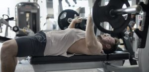 Man doing a barbell chest press