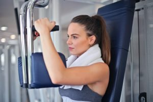 Woman using a chest workout machine